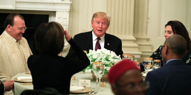 President Donald Trump joins an iftar dinner, which breaks a daylong fast, celebrating Islam's holy month of Ramadan, in the State Dining Room of the White House in Washington, Monday, May 13, 2019. (AP Photo/Manuel Balce Ceneta)